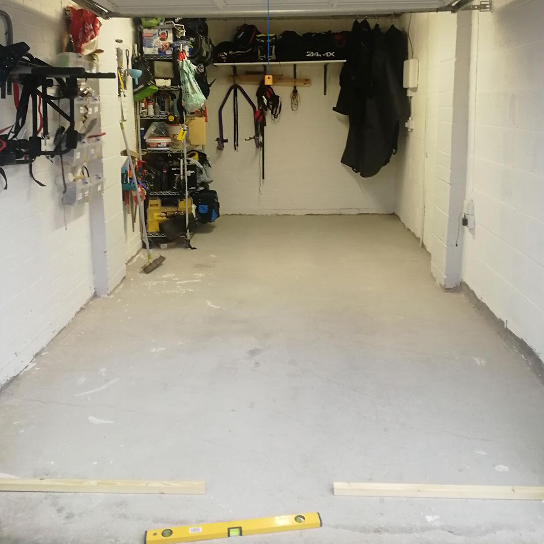 Before photo of garage floor