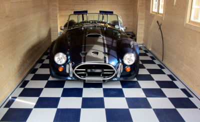 Blue Cobra AK427 on blue and white Mototile garage flooring.