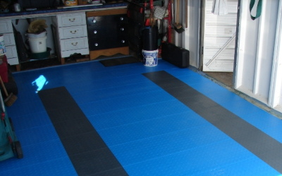 Floor tiles laid and garage ready to use again