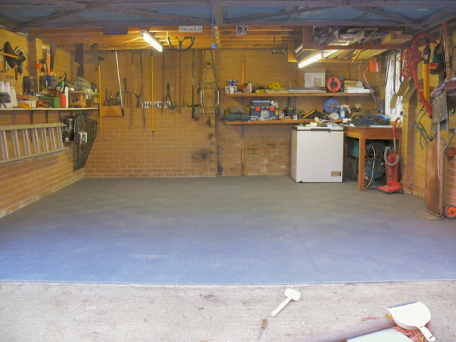 Garage floor layed with MotoLock recycled tiles.