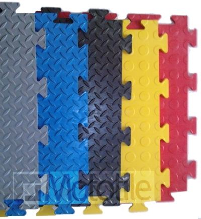 Interlocking PVC Floor Tiles - Coin-top and Checkerplate designs.