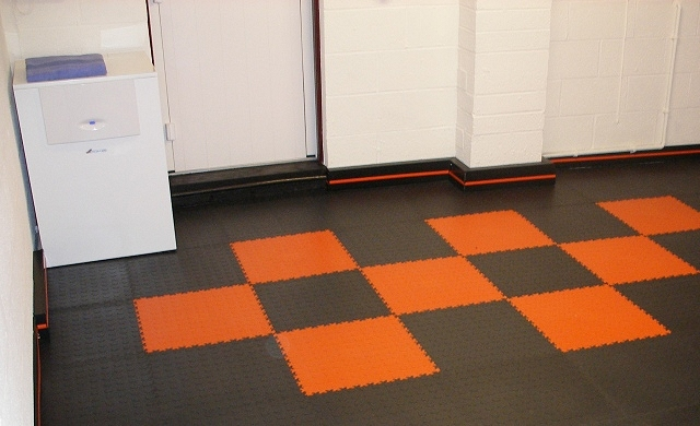 Black garage floor skirting with orange insert.