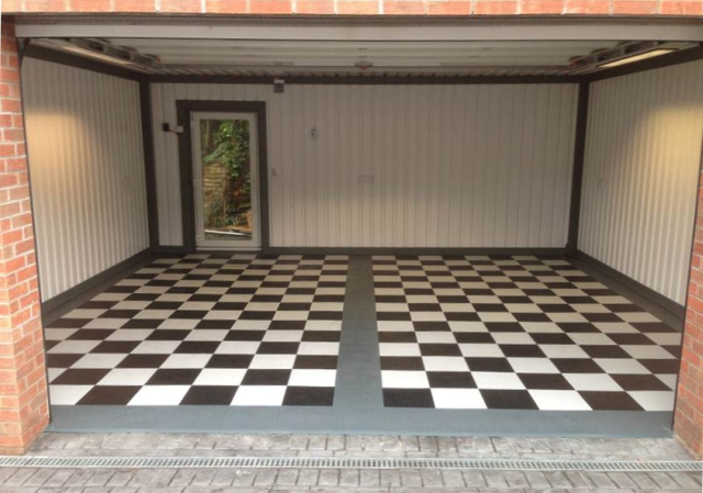Black and White check pattern floor using Mototile Seamless interlocking PVC tiles.