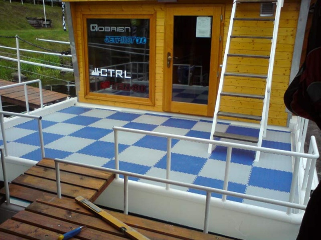 Interlocking floor tiles on houseboat deck.