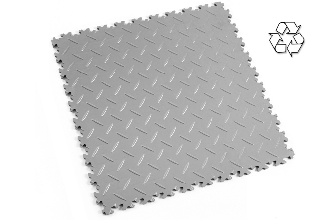 Recycled PVC content interlocking floor tiles.