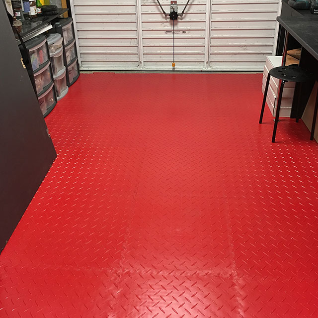 MotoLock Floor tiles installed in a small garage